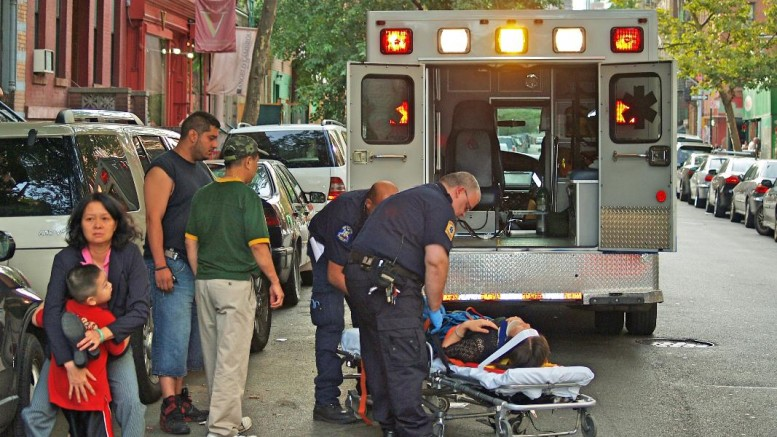 Woman collapses in the East Village of New York.